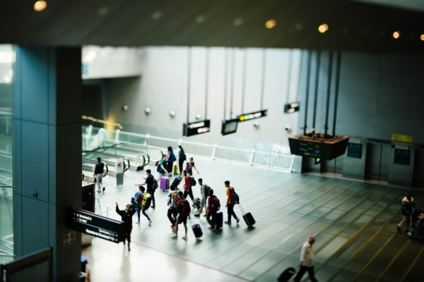 People in an airport heading to the barding gate