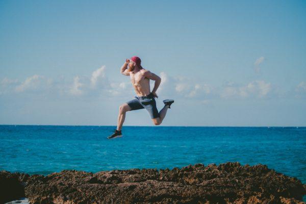 Man jumping in an amusing way