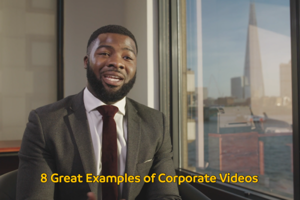 Man dressed smartly giving an interview and on-screen text reading 8 Great Examples of Corporate Videos