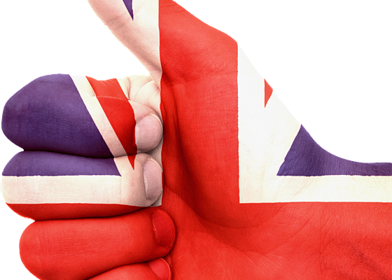 Hand showing the OK sign with UK flag painted on
