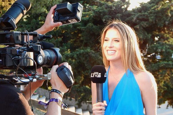 Reporter being filmed