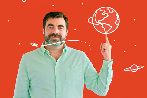 Man against a red background pointing to an animated planet