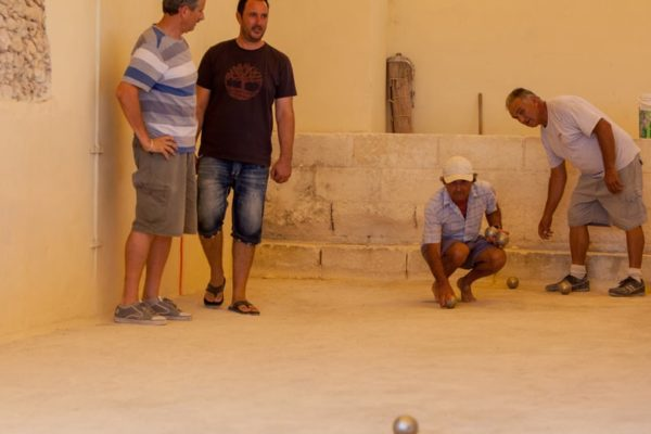 A group of men playing Gozo