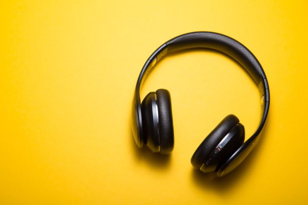 Wireless headphones on a bright yellow background