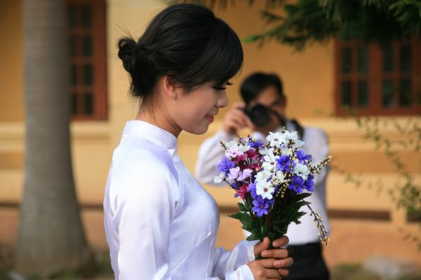 Woman holding flowers for a photoshoot