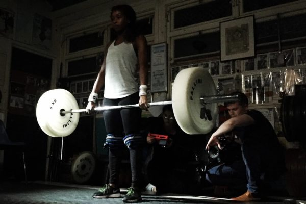 Girl liftin weights on the set of a Bold Content shoot for Coca Cola