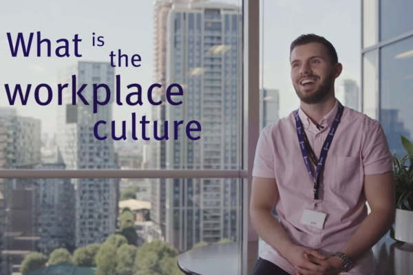 Man smiling and on-screen text reading 'What is the workplace culture?'