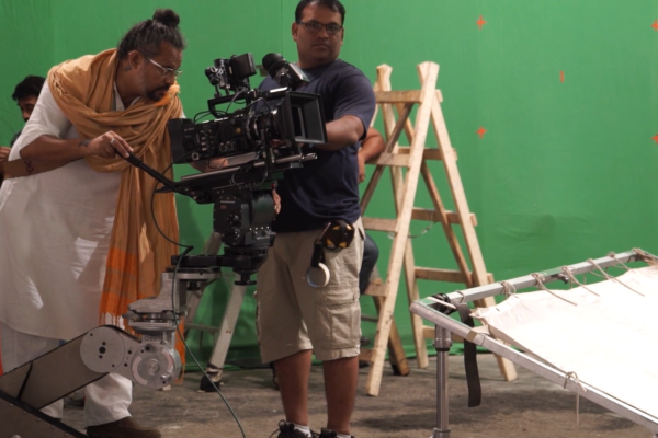 Behind the scenes: Camera crew filming on a green screen
