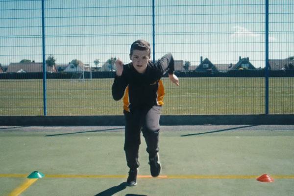 Boy running race towards camera