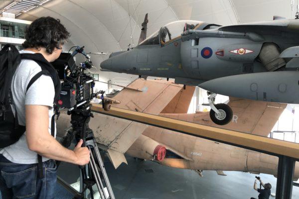 Cameraman shooting an airplane at RAF museum
