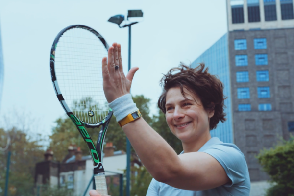 woman playing tennis celebrating