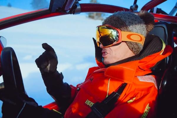 man driving a snowmobile