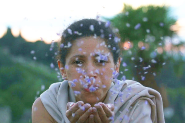 Actress blowing petals