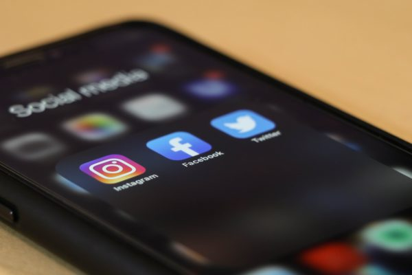 Mobile phone showing buttons for instagram, facebook and twitter
