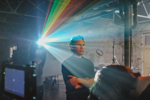 Projector colour spectrum and man on film set