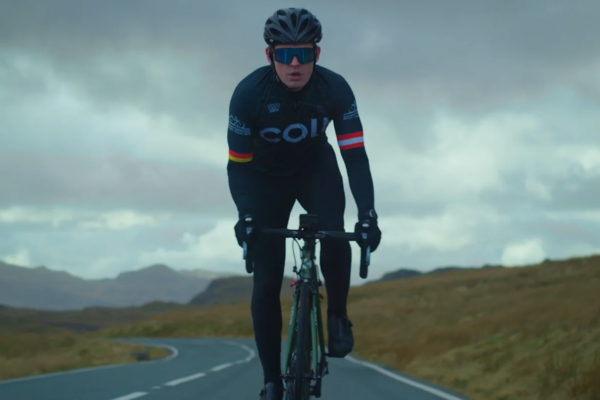 man in lycra cycling on an empty road