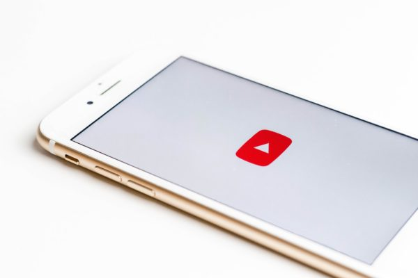 iphone with the youtube app icon